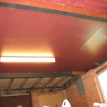 Second coat on the ceiling, looks a richer red